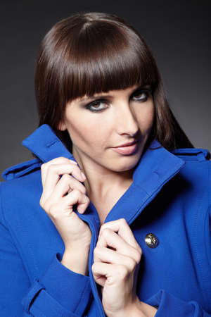 horse collar: Young brunette woman with blue coat in winter