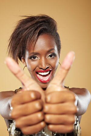 Young stylish african woman holding both her thumbs up Stock Photo - 11396196