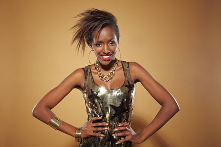 arms akimbo: Young happy african woman posing with her arms akimbo Stock Photo