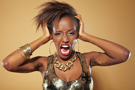 crazy hair: Screaming frustrated african woman pulling her hair