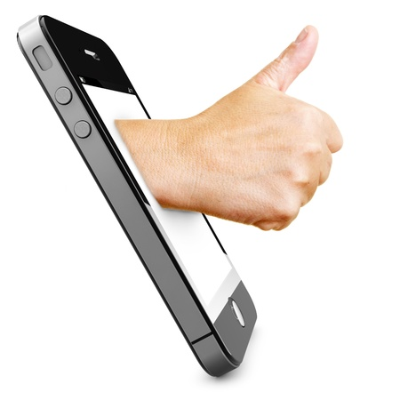 high performance: Hand in a smartphone display holding thumbs up Stock Photo
