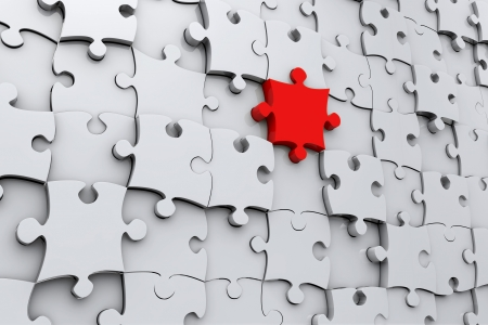 benchmark: Red jigsaw puzzle piece in 3D in a wall of grey pieces