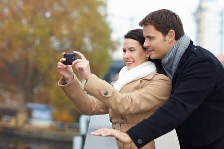 Tourists on a city trip taking photos with smartphone Stock Photo - 11396191