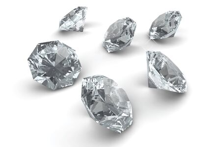 Many sparkling diamonds laying on white floor Stock Photo