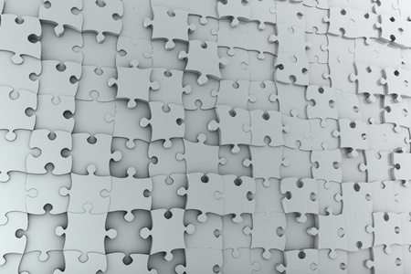 Abstract background jigsaw puzzle wall made from many different grey pieces photo