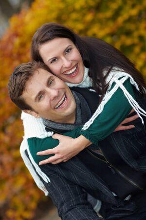 Happy smiling couple having fun in autumn photo