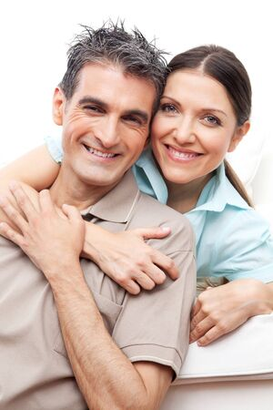 Portrait of happy senior couple smiling and embracing photo