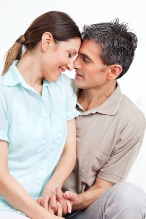 Couple in love smiling at each other and holding hands Stock Photo - 12108797