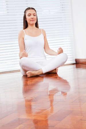 meditation room: Elderly woman meditating relaxed in her living room