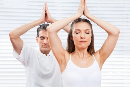 Senior man and woman relaxing and meditating in fitness center photo