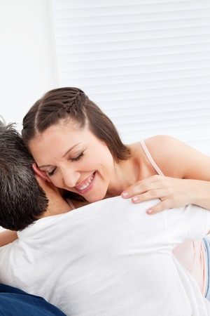 Elderly happy woman embracing her man in bed Stock Photo - 12108729