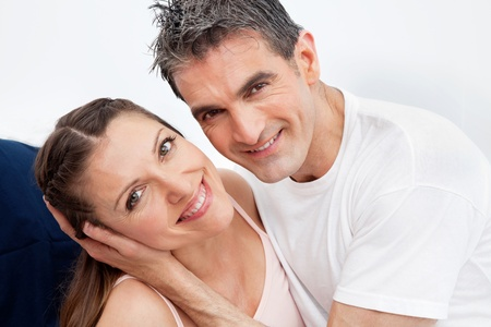 Happy smiling married couple having fun in bed Stock Photo - 12108733