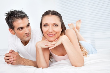 Happy smiling senior couple laying in bed Stock Photo - 12108710