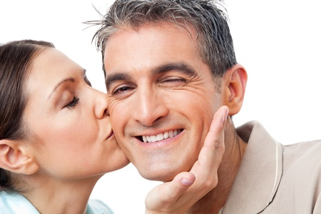 Elderly woman in love kissing happy man on cheek Stock Photo - 12108825
