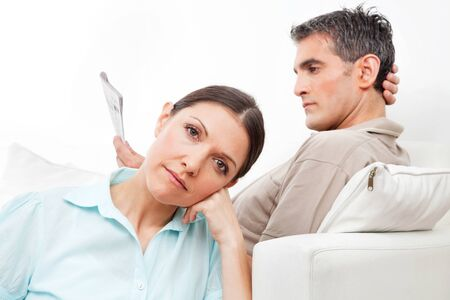 Elderly couple at home giving each other the silent treatment photo