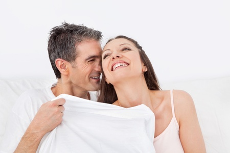erotic couple: Elderly happy couple laying in their bed