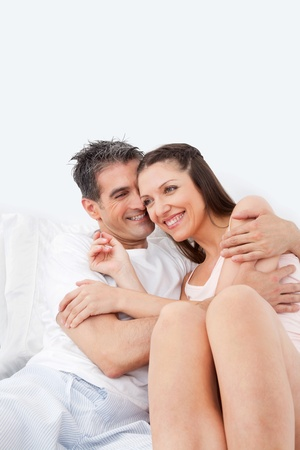 Elderly happy woman embracing her man in bed Stock Photo - 12108846