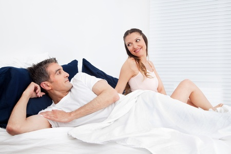Happy smiling senior couple laying in bed Stock Photo - 12108841