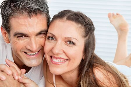 Happy smiling senior couple laying laughing in bed Stock Photo - 12108870