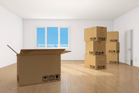 Many moving boxes in bright clean empy apartment room photo