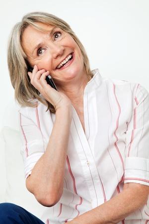 Happy smiling senior woman talking on the phone Stock Photo - 12361423