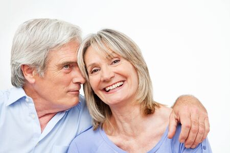 Happy smiling senior couple embracing at home photo