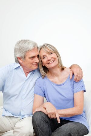 matchmaking: Portrait of happy smiling senior couple embracing at home