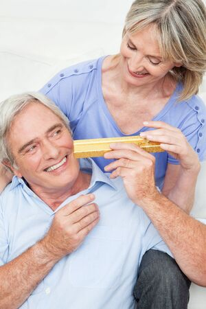 Senior man giving woman a Valentines Day gift photo