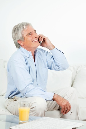 Happy senior man laughing on the phone Stock Photo - 12361533