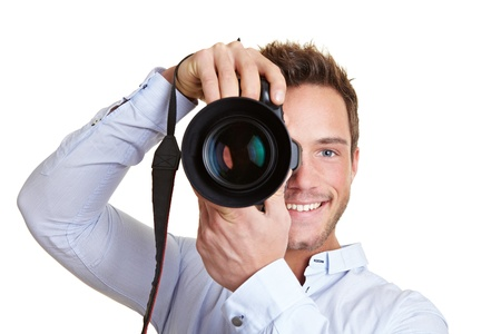 Happy professional photographer with digital DSLR camera photo