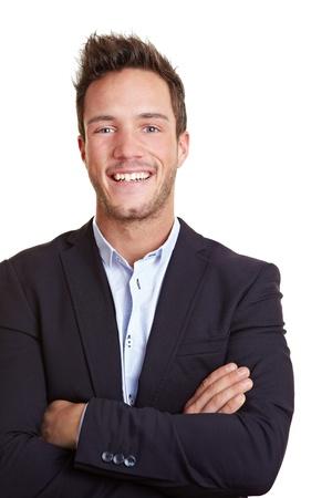 foto carnet: Feliz sonriente hombre de negocios con los brazos cruzados
