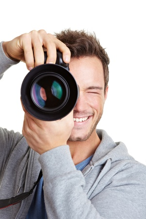 photographer: Young photographer taking pictures with digital camera
