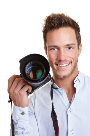 reportero: El periodista Feliz sonriente con c�mara digital en la mano Foto de archivo