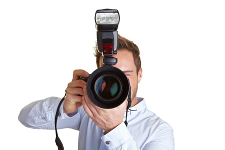 Paparazzo photographer with digital camera and flash unit photo