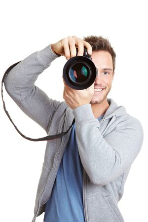 Happy man taking pictures with digital camera photo