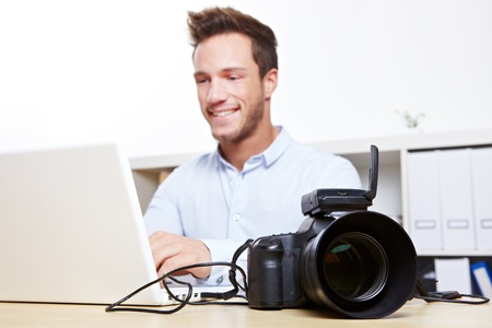 Data transfer with USB cable from digital camera to laptop computer photo