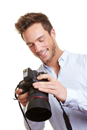 Photographer checking images on digital camera display photo