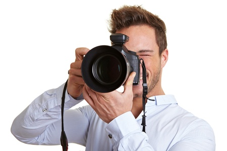 Professional photographer taking pictures with digital DSLR camera