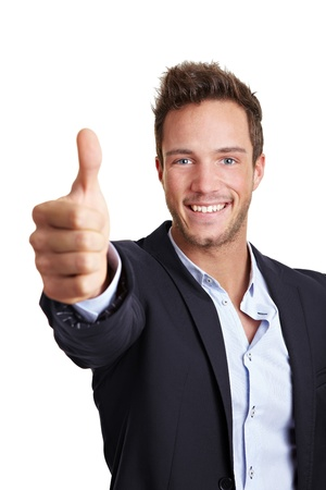 confidence: Happy young business man holding his thumbs up