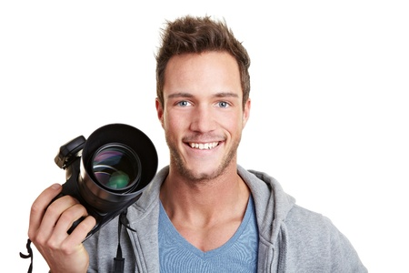 Happy photographer holding digital camera with remote trigger