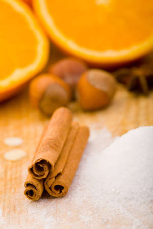 cinnamon stick: Cinnamon, sugar and other spices on cutting board Stock Photo