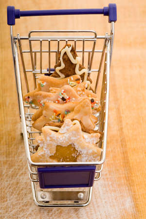 Different christmas cookies in a small shopping cart photo