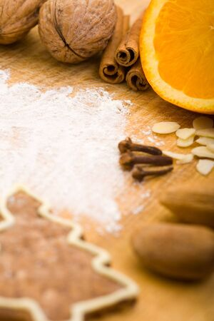 Different baking ingredients and wheat flour on cutting board photo