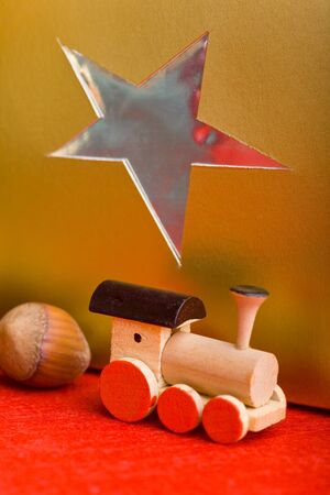 Wooden toy train with hazelnut and christmas gift photo