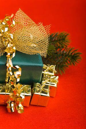 small gifts around big christmas gift on red background stock photo 12856208 - Big Christmas Gifts