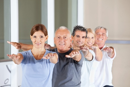 Group of happy senior people doing back exercises in fitness center Stock Photo - 12953260