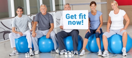 Get Fit Now advertising in fitness center with senior group
