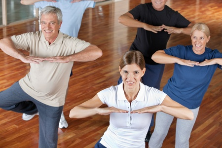 Senior citizens doing dance training in fitness center photo