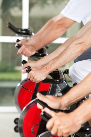 spinning wheel: Many different hands on fitness machines in gym