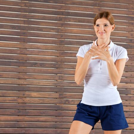 Female fitness trainer giving instructions in gym photo